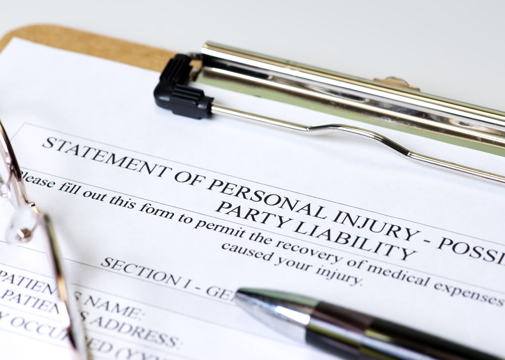 personal injury liability form sitting on an injury attorney's desk for a whiplash case