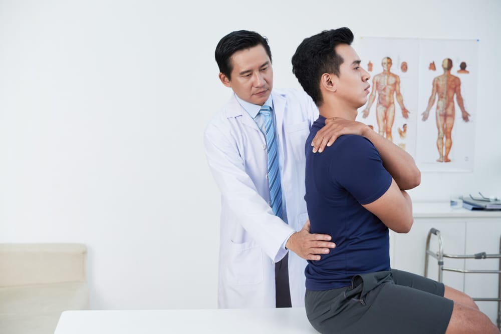 new york man getting his low back pain treated by a doctor after a car accident